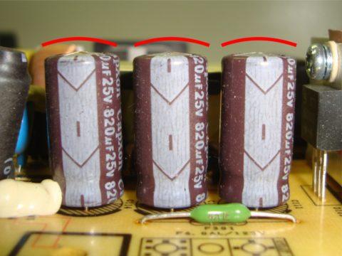 Данные конденсаторы вышли из строя без взрыва, об этом можно судить по вздувшимся крышкам бочонков